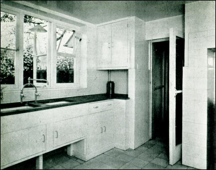Kitchen, with twin sinks and built-in cupboards