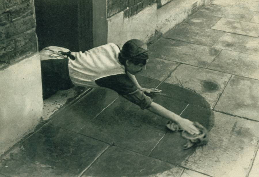 A Lady Cleans Her Doorstep